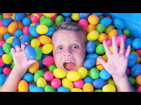 Giant Surprise Easter Egg Hunt POOL! FIND THE GUMMI CANDY EGG Challenge Kyle's Toys & Games Fun