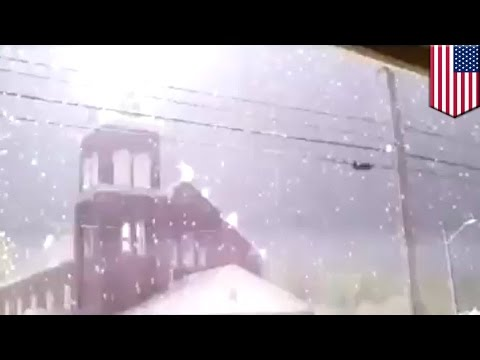 Lightning strikes church cross with enormous force in incredible cell phone video - TomoNews