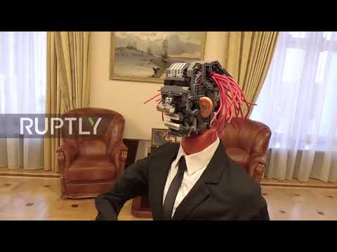 Suited and botted! Robot with pink dreads mumbles through St. Petersburg's 2018 budget