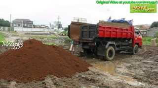 Mitsubishi Colt Diesel Unloading Red Dirt