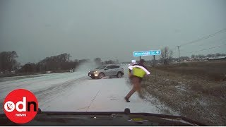 Look behind you! Police officer turns just in time to dodge skidding SUV