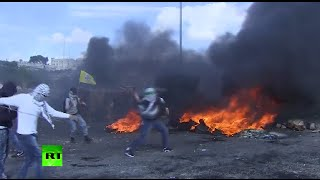 Burning tires, tear gas & stones: Palestinian youths clash with Israeli forces