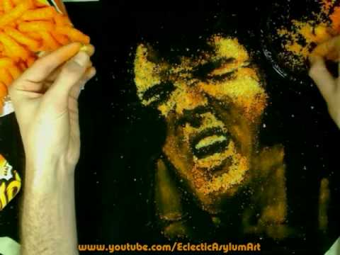 Elvis Presley Painting with Cheese Puffs on Velvet - Cheesy Artin Cheetos
