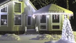 видео Украшение фасадов домов гирляндами, оформление загородного дома