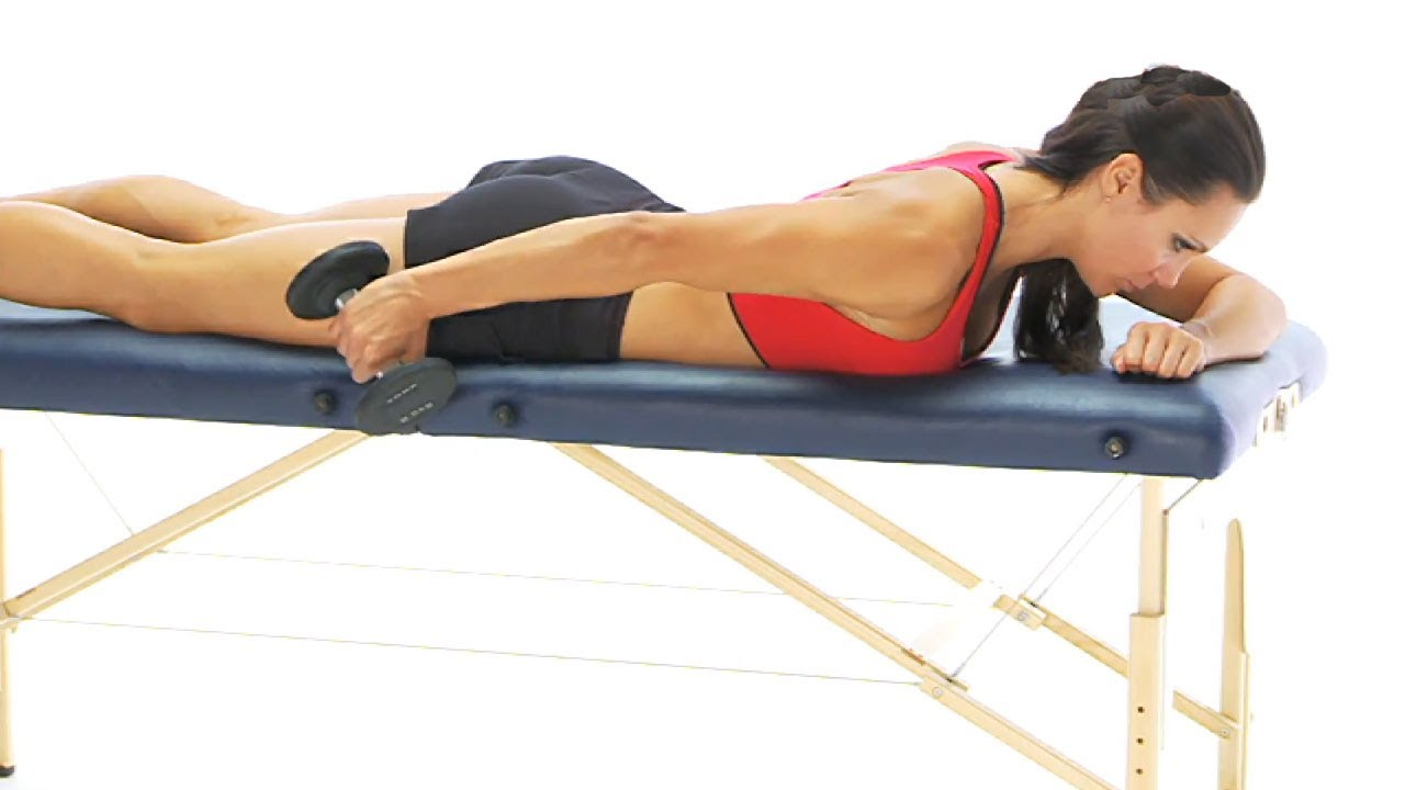 ... exercise - Extension in prone with dumbbell for rehab - YouTube