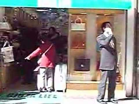 Ginza, Tokyo, hand bag merchant takes charge