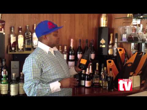 Kenny Kunene behind his bar