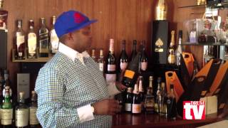 Kenny Kunene behind his bar