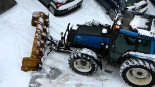 Parking lot snow plowing with Valmet 6800 tractor in Oslo, Norway