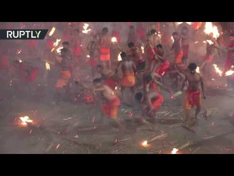 'Fire fight': Devotees brawl with burning palm fronds to appease Hindu goddess Durga