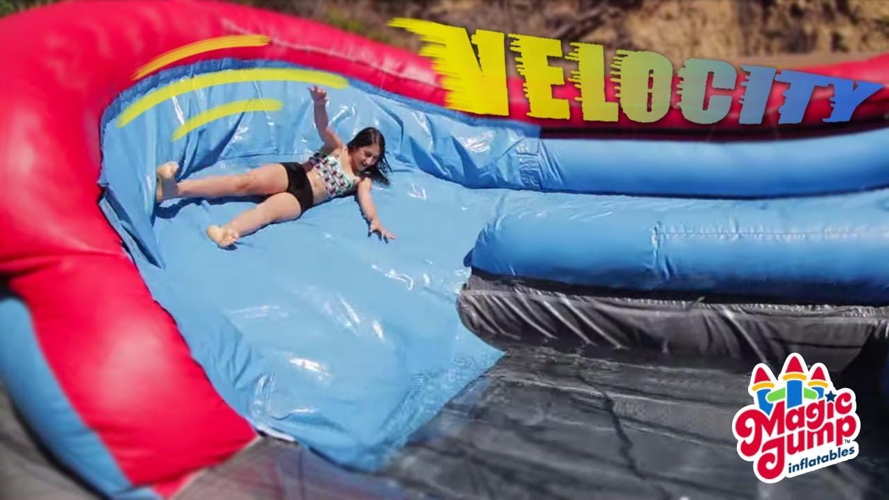 velocity u curve inflatable water slide magic jump inc youtube