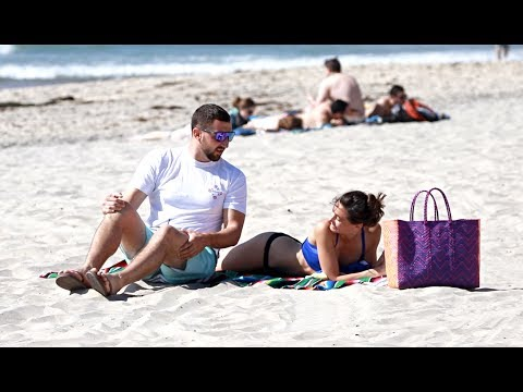 Sitting on People's Beach Towels