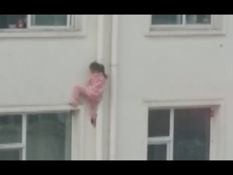 Man's Quick Thinking Saves Girl Dangling From Building In Shanxi