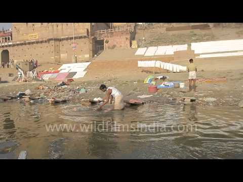 Bathing and drying clothes on the banks of river Ganges - Varanasi