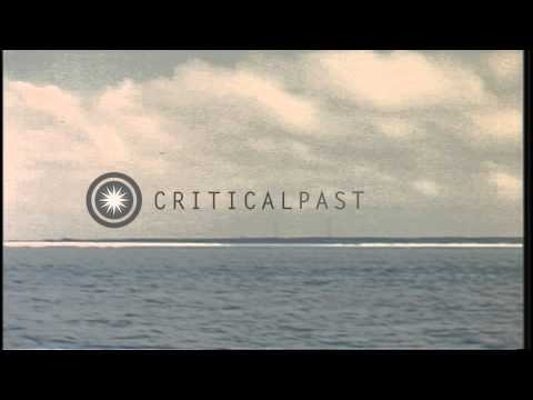 USS Bluegill (SS-242) reconnoiters and shells Pratas Island in the Pacific during...HD Stock Footage