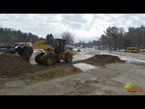 Cat 926M Cleaning Up Parking Lot