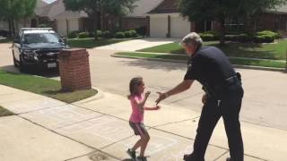 Detective Takes Time From Break to Play Hopscotch With Local Child