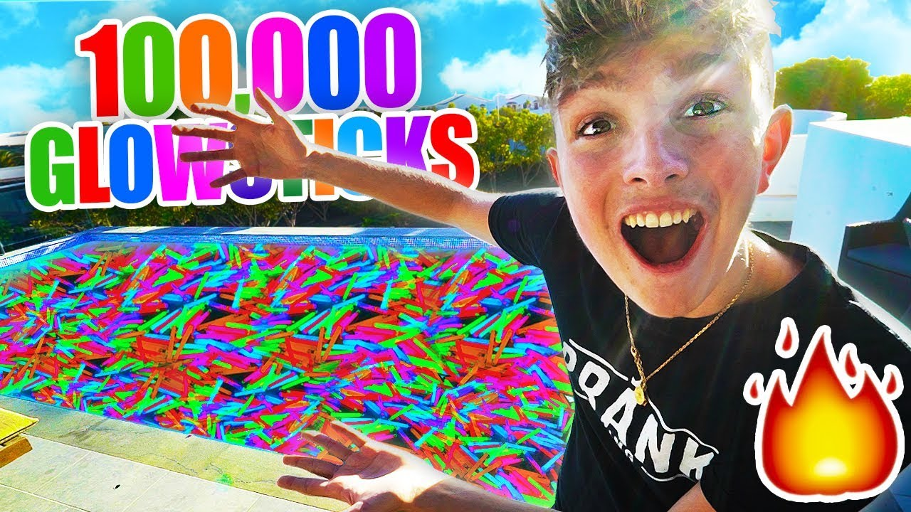 Filling My Pool With 100 000 Glow Sticks Lit Youtube