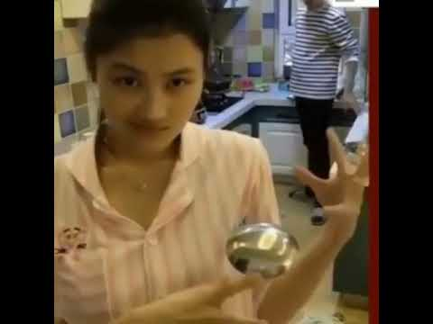 Chinese girl gets hit in head while doing magic