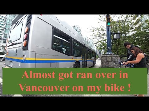 Riding my bike through downtown Vancouver on a cloudy day.