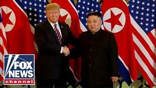 Trump, Kim greet one another with handshake in Vietnam