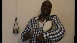 How To Play a Simple Rhythm On The Talking Drum