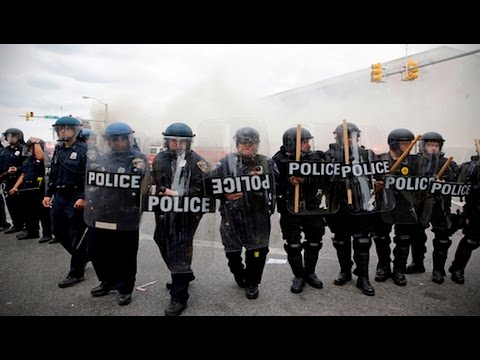 Police Tactics of Mass Arrests, Violence and Overcharging Protesters First Developed in 2000
