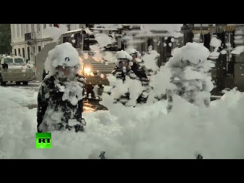 Video: Firemen soak cops in foam protesting cuts in Brussels