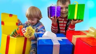 Funny babies playing with Toys and open Christmas and New Year presents by iFinger