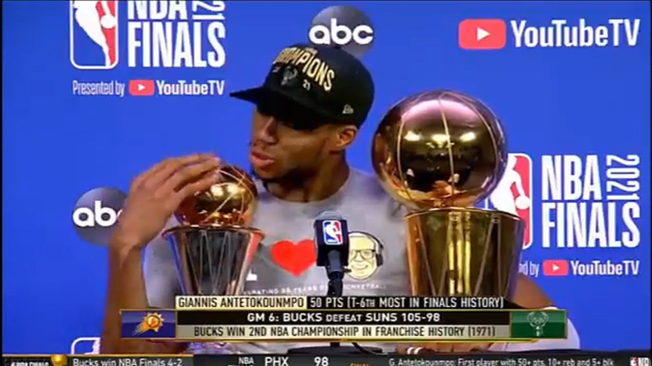 Giannis kisses the NBA Finals trophy and tells his Finals MVP trophy to not get jealous 🤭