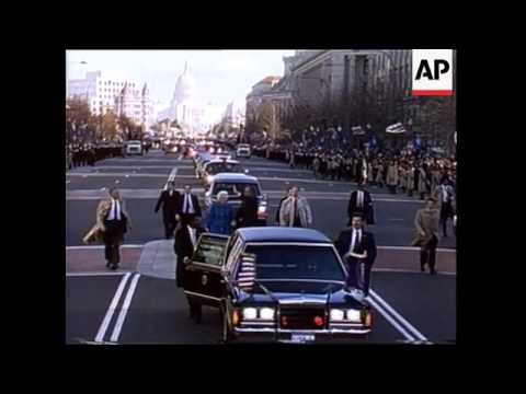 President George H.W. Bush and his wife Barbara walk along Pennsylvania Ave. during the Inaugural Pa