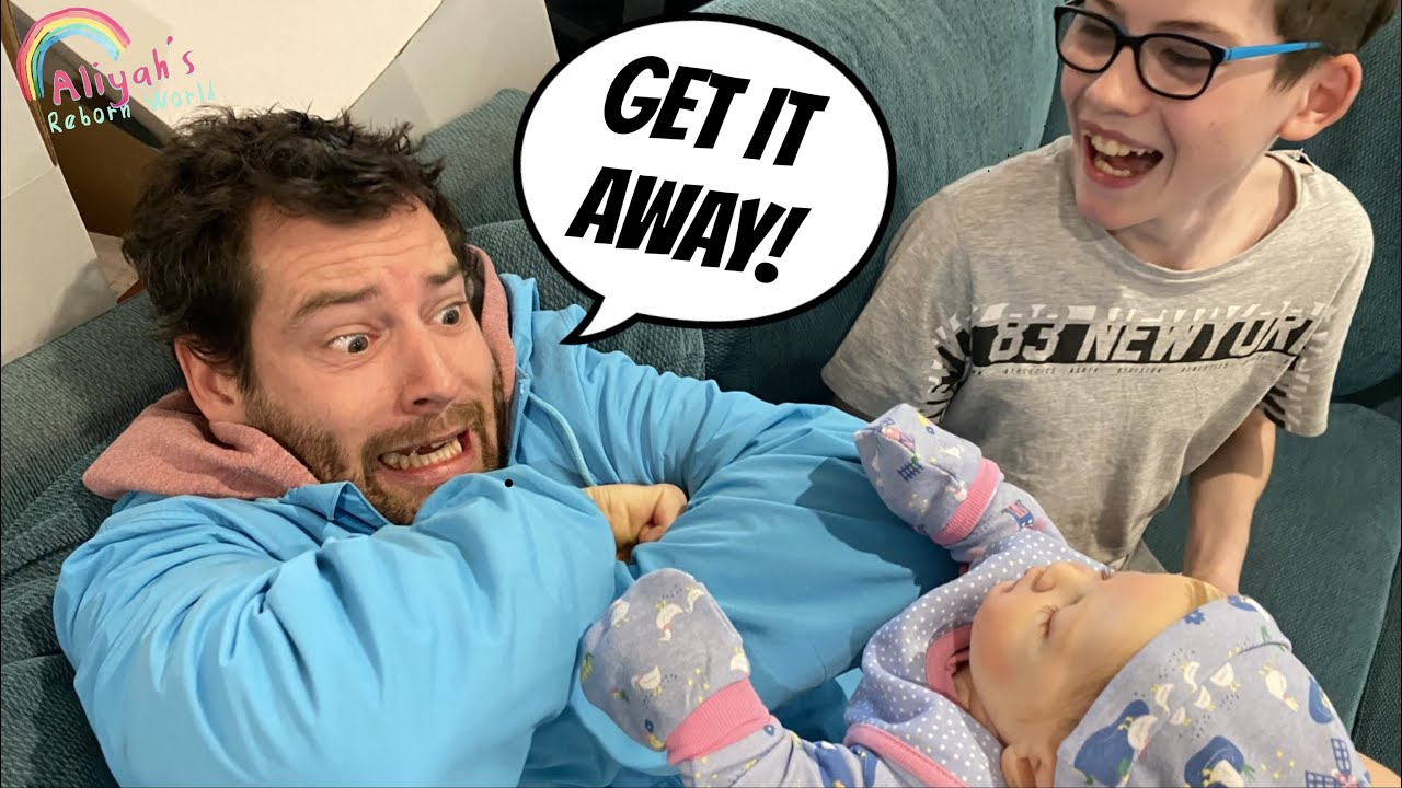DAD HOLDS A REBORN! HILARIOUS REACTION