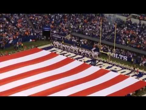 Bald Eagle Flies Over A Giant American Flag Before A Colts Game
