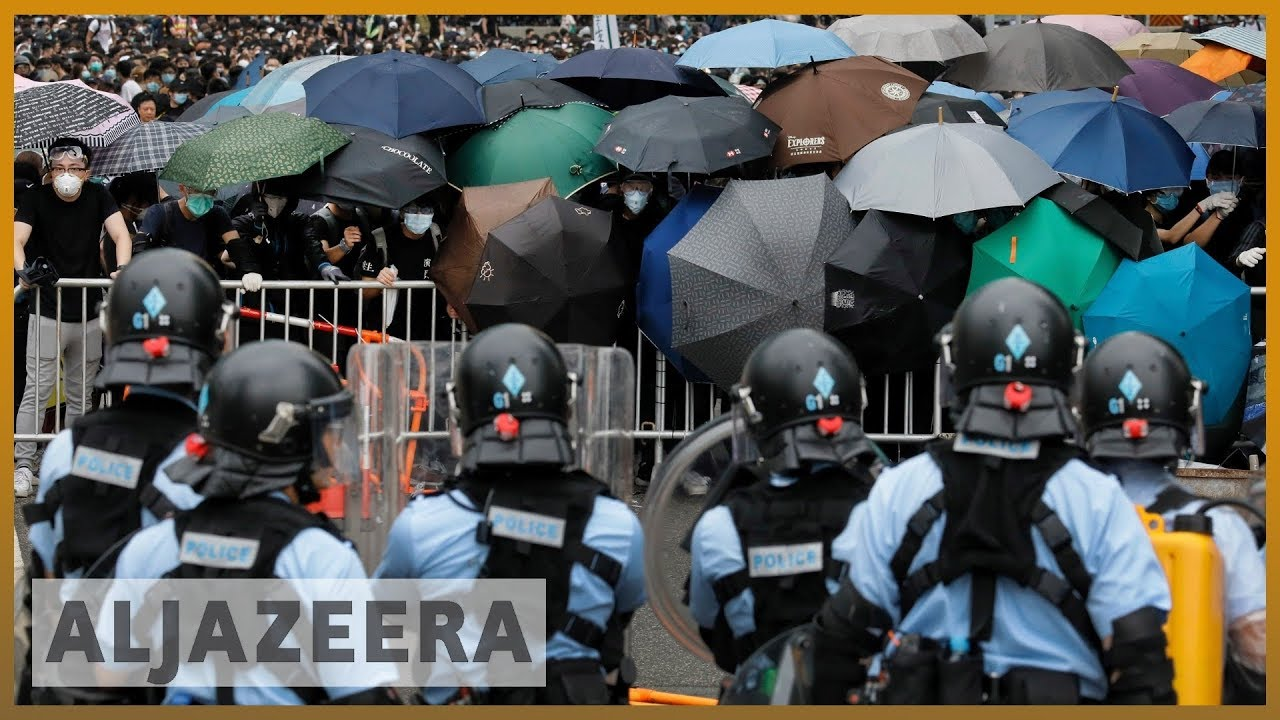 AlJazeera English:Hong Kong protesters block access to government headquarters