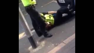Police officers push there panic button and use CS spray to subdue resisting man