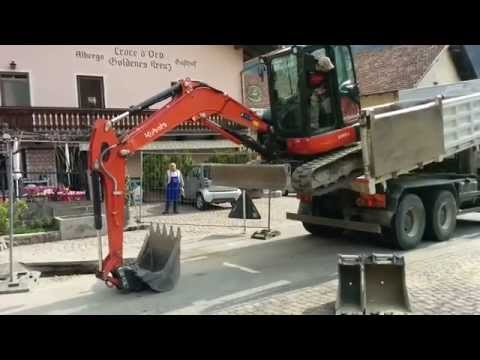 Excavator Unload From A Truck In A Different Way