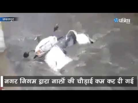 Vehicles floating in Rain water
