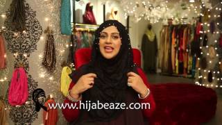 Stand for Zainab (a. s) wearing Hijabeaze