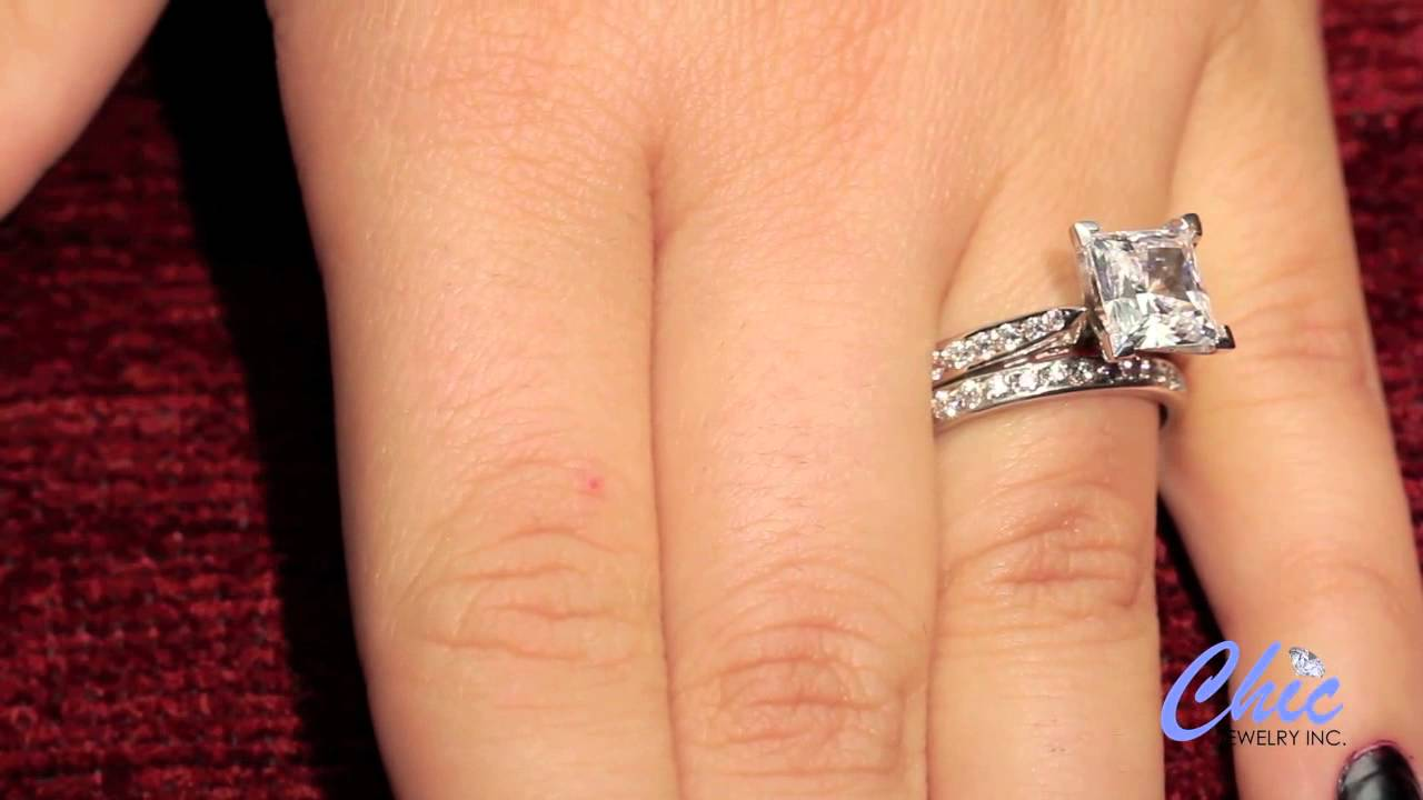 Delicate wedding ring set with 2 carat princess cut cubic zirconia