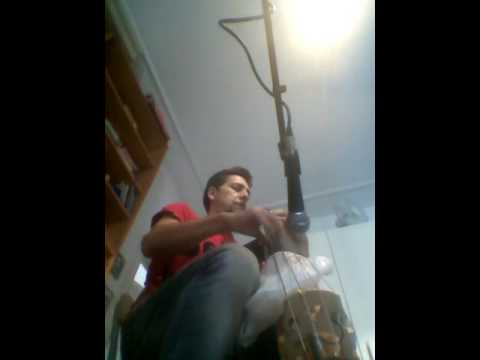 Upright bass african style (with plastic bag on the strings)