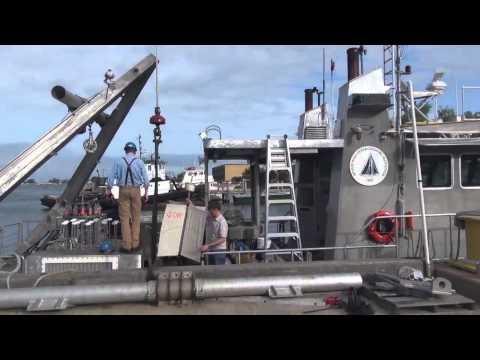 Captain Ken loading drifter onboard