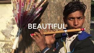 street boy play flute