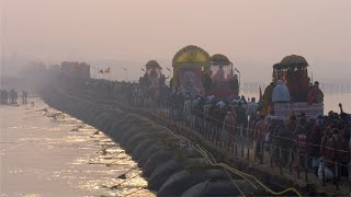 Thousands of Hindu devotees crossing the bridge over the Ganges river at Kumbh