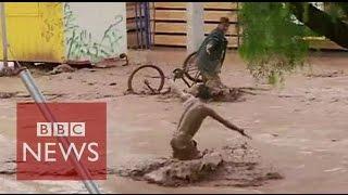 Peru & Chile devastated by flood torrents - BBC News