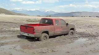 Chevy 2006 Z71 playing in a sloppy mud hole.