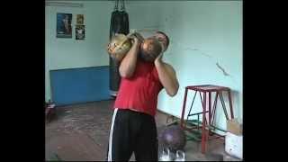 Две гири общим весом 89кг - правой. 89kg (kettlebells 57kg+32kg) push press