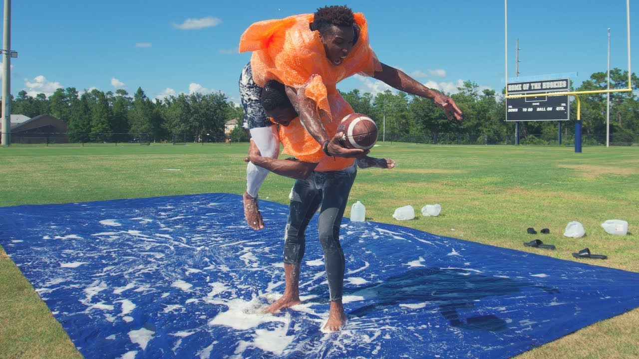 slip-and-slide-tackle-football-wearing-bubble-wrap-pads-he-got-popped