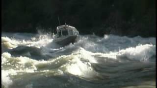 Jet boat struggles in rapid.