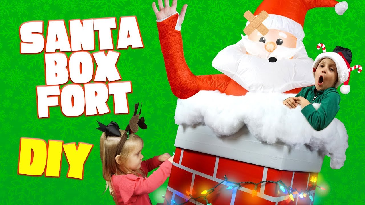 Diy christmas box fort for kids with a giant inflatable santa claus diy christmas box fort for kids with a giant inflatable santa claus solutioingenieria