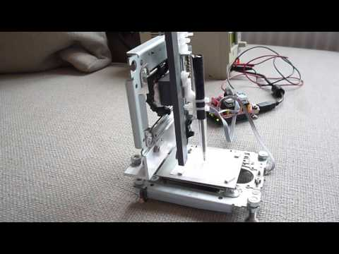 Homemade small X-Y-Z CNC machine made from 3 cdrom drives